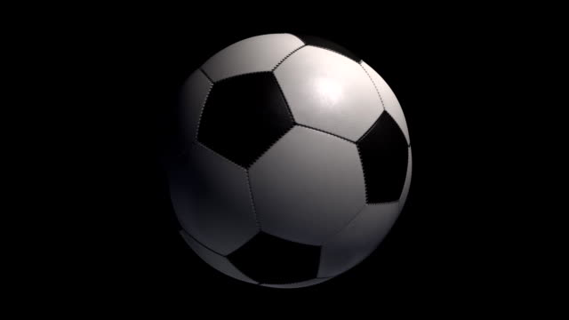 Soccer Ball turning on a black background with alpha. video