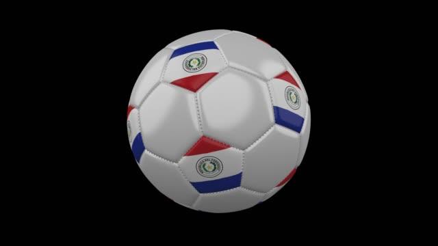 soccer ball with flag paraguay, loop, 4k alpha - парагвай стоковые видео и кадры b-roll