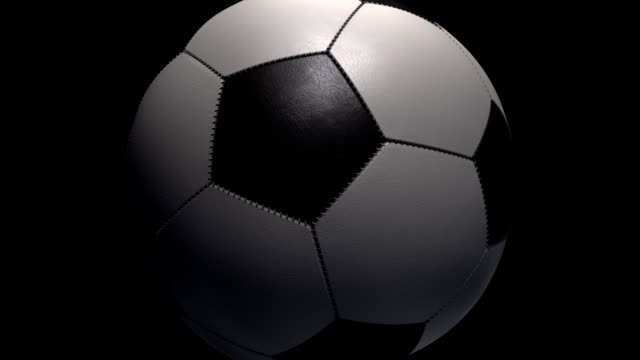 Soccer Ball zoom out on a black background with alpha. video