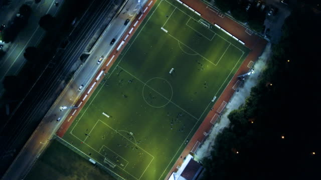 Soccer field at night - aerial view video
