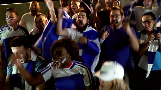 4K: Soccer / Football fans in Stadium celebrating goal being scored video