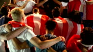 istock Soccer / Football fans in Stadium doing 'The Poznan' - Super slow motion 858429920