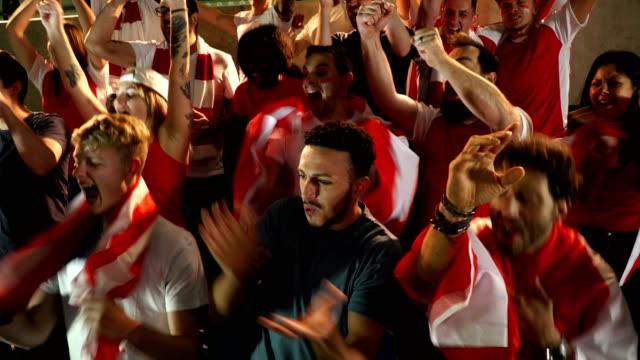 Soccer / Football fans in Stadium rue near miss - Super Slow Motion video