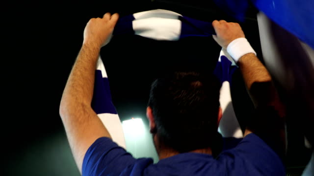 4K: Soccer / Football fans & Supporters with Scarf in Stadium video