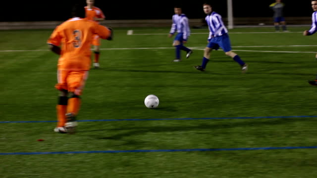stockvideo's en b-roll-footage met soccer / football match passing the ball and scoring goal - passeren