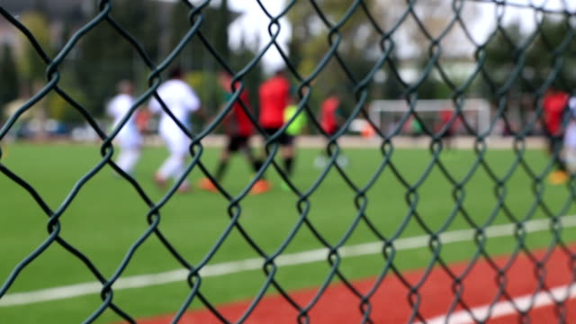 Soccer game behind the fence video