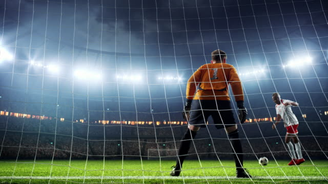 Soccer goalie fails to catch a ball Soccer goalie fails to catch a ball on a prefessional soccer stadium. Athlete wears unbranded sport clothes scoring a goal stock videos & royalty-free footage