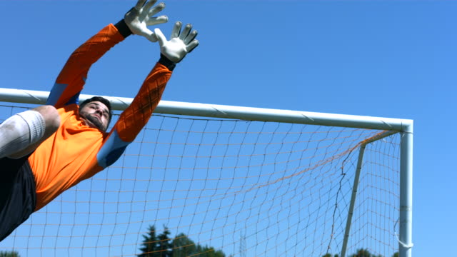 Soccer goalie makes a save, slow motion video
