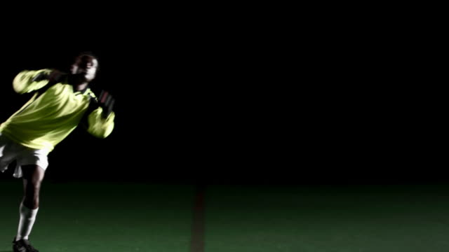 Soccer goalie stops the ball  diving to the ground stock videos & royalty-free footage
