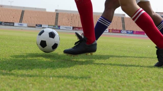 vídeos de stock e filmes b-roll de soccer or football player standing with ball on the field for kick the soccer ball at football stadium - campeão soccer football azul