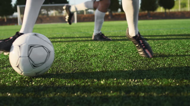 A soccer player does some fancy footwork while dribbling down the field video