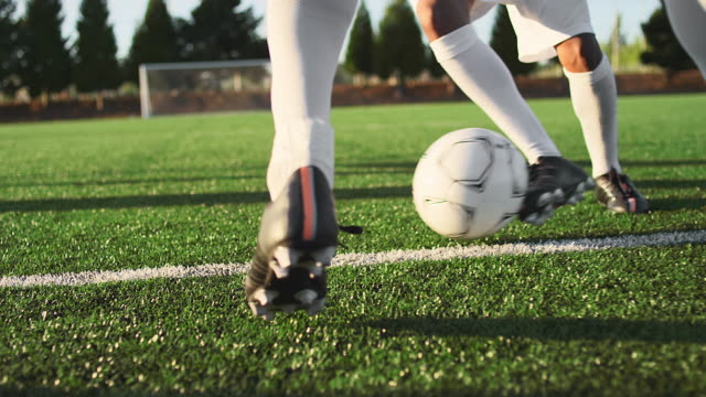 A soccer player does some fancy footwork while going up against other players