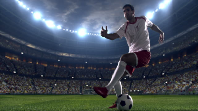 Soccer player dribbling a ball on the field video
