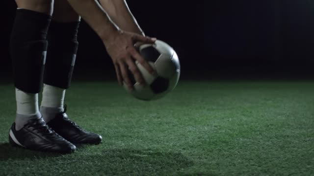 Soccer Player Kicking Ball at the Beginning of Match video