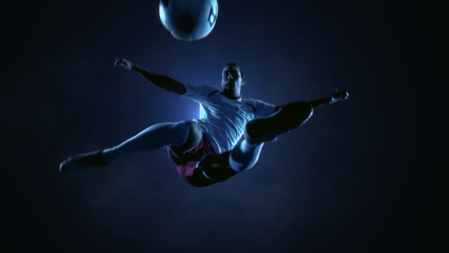 Soccer Player Kicking Ball in jump
