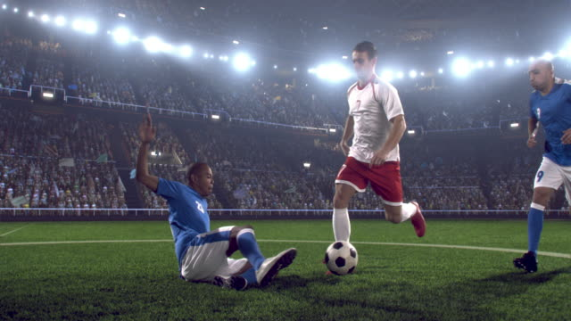 Soccer player kicking ball in stadium video