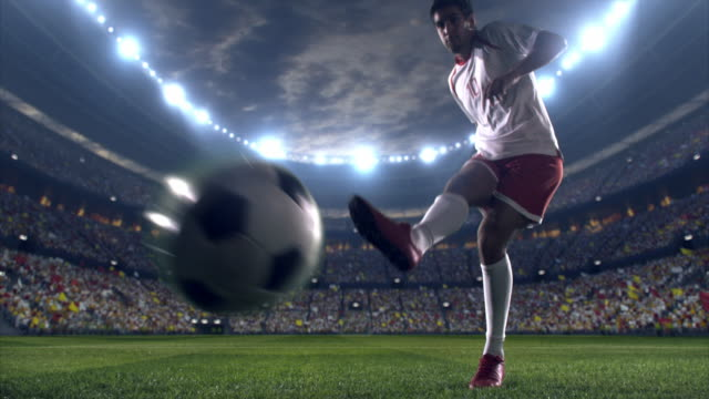 soccer player kicks a penalty - sports fans stock videos and b-roll footage