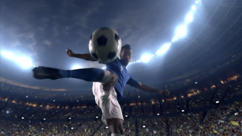 Soccer player makes a dramatic play 4K video in slow motion of a Soccer player makes a dramatic play by kicking a ball with his feet during a soccer game on a professional outdoor soccer stadium. The player is wearing unbranded soccer uniform. The stadium is with animated crowd. Stadium and crowd are made in 3D. competition stock videos & royalty-free footage
