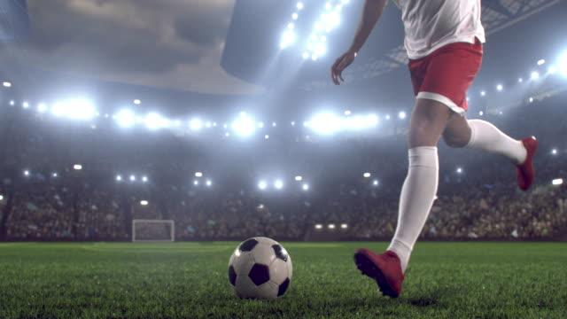Soccer player makes a kick video