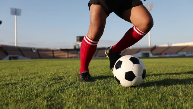 soccer player show footwork and Soccer player kicking and Shooting ball on goal in slow motion video