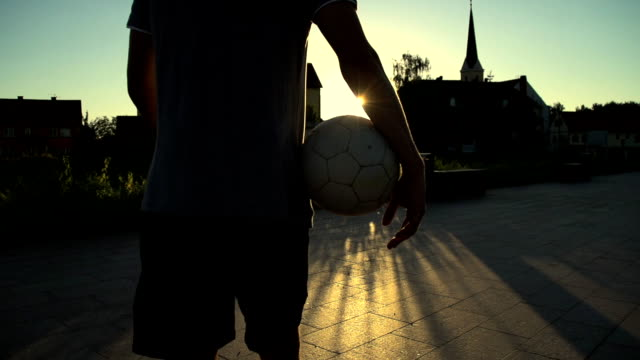 HD SUPER SLOW-MO: Soccer Player Walking Away video