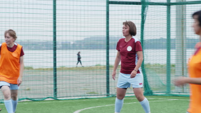 Soccer players on field in summer Soccer player giving advices to her teammate during match, but rival shooting goal anyways goal post stock videos & royalty-free footage