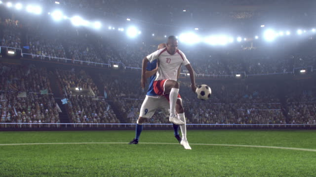 Soccer players on stadium Soccer player makes catches a ball with his feet and continue his attack. The opposite team player tries to block him. The players wear unbranded soccer uniform. They are on stadium with animated crowd. Stadium and crowd are made in 3D. floodlit stock videos & royalty-free footage