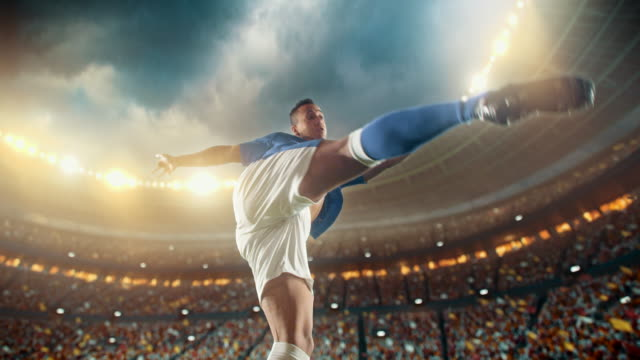 vídeos de stock e filmes b-roll de soccer: professional player makes a strong kick - chutar