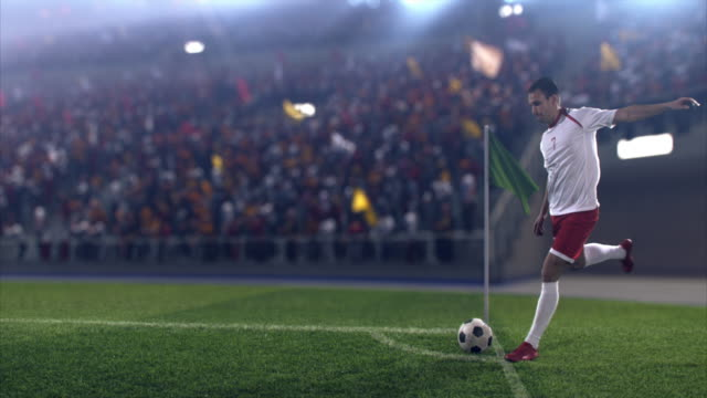 Soccer: Professional player performs a corner kick 4K video in slow motion of a Soccer player performs a corner kick during a soccer game on a professional outdoor soccer stadium. The player is wearing unbranded soccer uniform. The stadium is with animated crowd. Stadium and crowd are made in 3D. floodlit stock videos & royalty-free footage