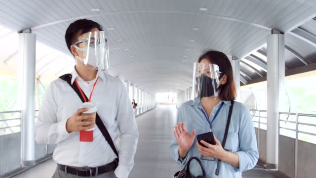 social distancing asian people protect by wearing protective face mask. - new normal video stock e b–roll