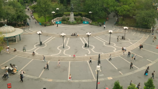 Social Distancing: People walk in the plaza of Union Square Park in midtown Manhattan New York City USA