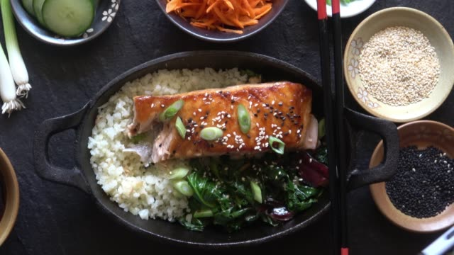 Social Media Food Photography of Gourmet Grilled Salmon Fillet with Asparagus and Cauliflower Rice. video