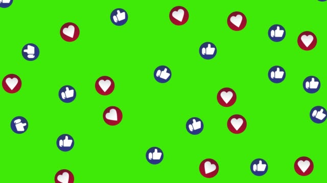 Social media video emoticon overlays flowing down. Social nets blue thumb up like and red heart floating web icons. Green screen for easy keying.