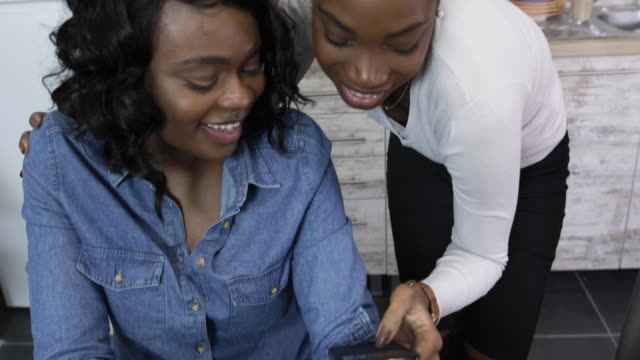 Social Network Two young African women using modern technology at home prop stock videos & royalty-free footage