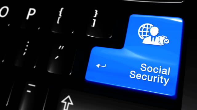 コンピュータのキーボードボタン上の社会保障移動運動。 ビデオ
