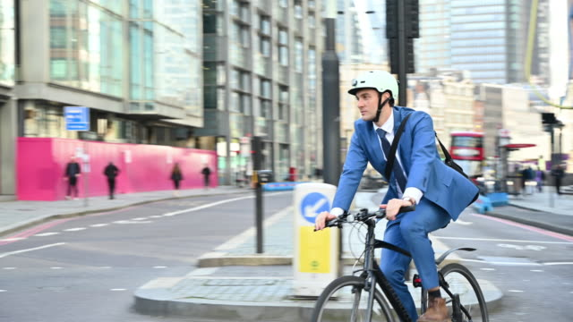 Socially responsible British businessman cycling to work