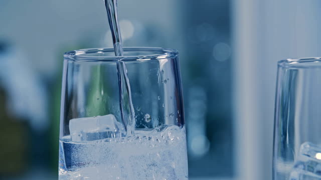 Soda Water Pouring soda water into a glass tonic water stock videos & royalty-free footage