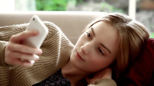 Sofa text message, pretty girl. video