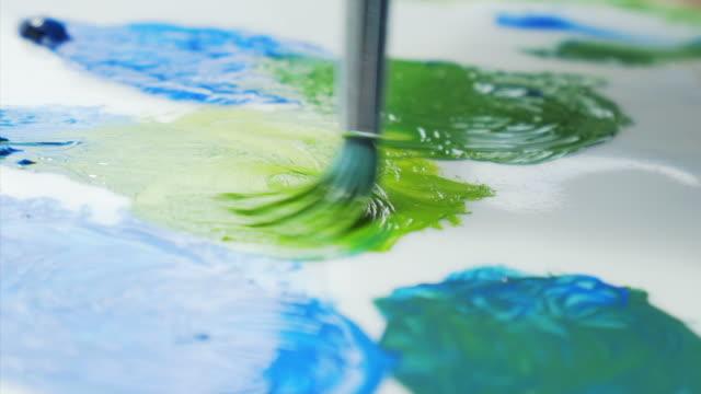 Soft bristle brush picking up paint.