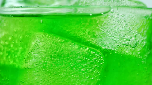 soft drink green apple juice close-up white background 4k resolution - soda pop stock videos and b-roll footage
