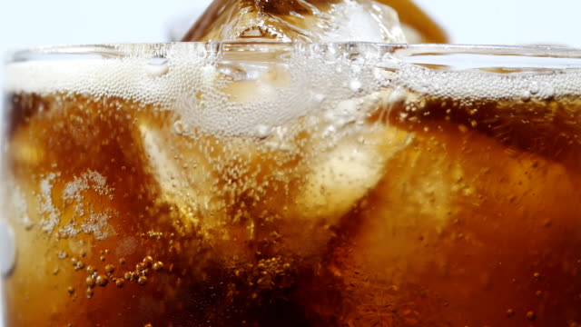 Soft drink with drinking glass Soft drink with drinking glass 4k cola stock videos & royalty-free footage