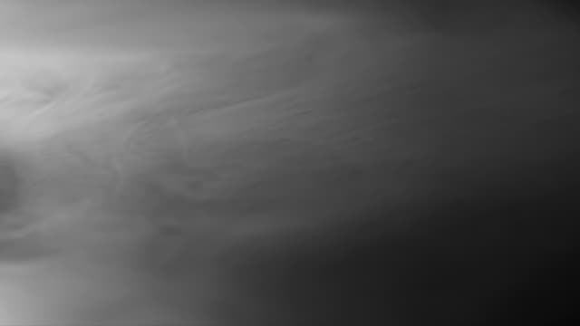 Soft Fading Fog Heavy white smoke slowly spreads over the black surface gradually dissolving heat haze stock videos & royalty-free footage