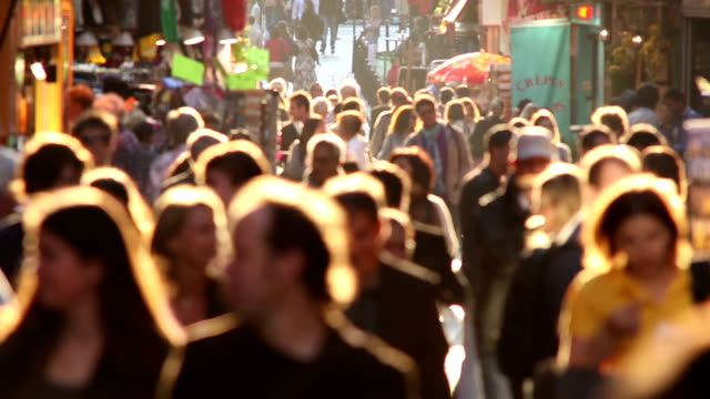 Soft focus crowd at golden hour video