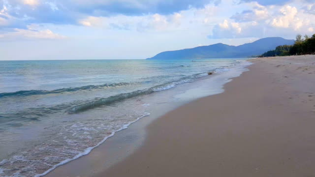 Soft wave of blue sea on the sandy beach. Background. Bumpy tropical sandy beach with blurry blue ocean and sky grace bay stock videos & royalty-free footage