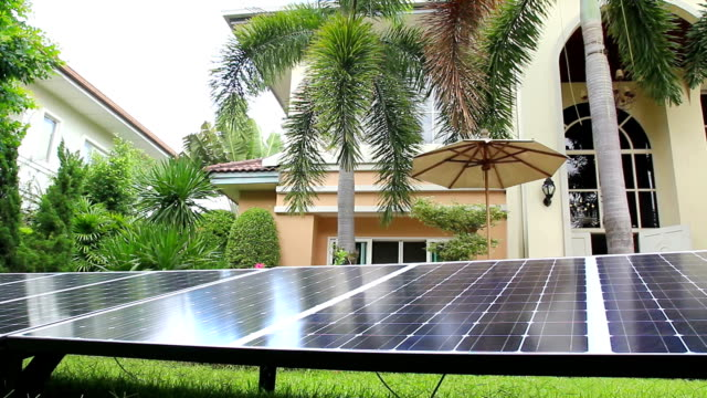 Solar panel on grass field in the house area video