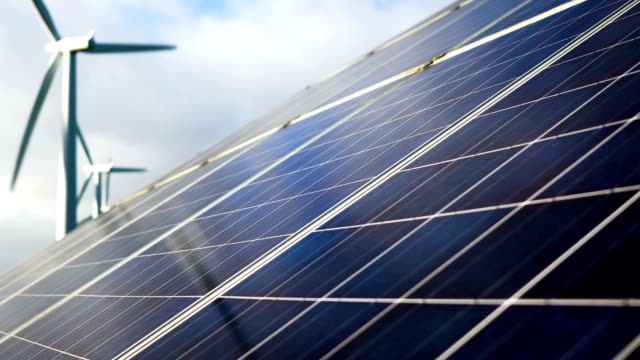solar panel with turbines - energia rinnovabile video stock e b–roll