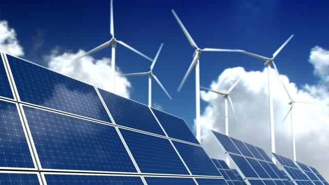 solar panels and wind turbines - green energy - rüzgar türbini stok videoları ve detay görüntü çekimi
