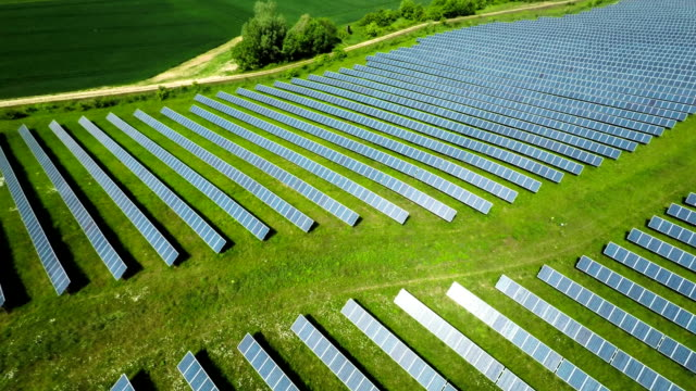 AERIAL: Solar Panels from a solar power plant Flight over rows of solar panels. Solar power station in germany. Concept for renewable and regenerative energy. renewable energy stock videos & royalty-free footage