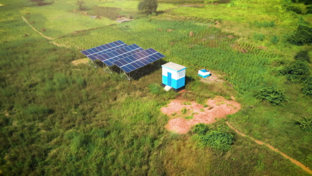 Solar panels in Tanzania Aerial drone shot of solar panels as a renewable energy source in remote areas of Tanzania, Africa plays a central role in development of sustainable resources. The solar power panels providing green energy stand out in the beautiful African savannah developing countries stock videos & royalty-free footage