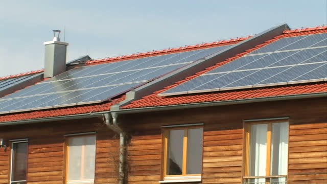 solar panels on a roof - solar panels stock videos & royalty-free footage